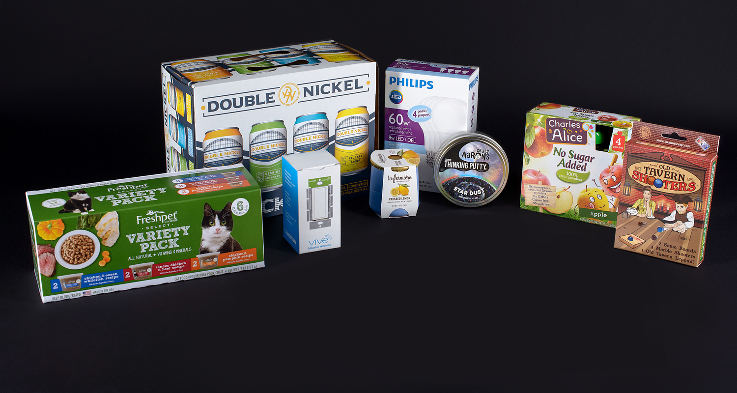 Consumer packaging shown for cat food, yogurt, games, applesauce